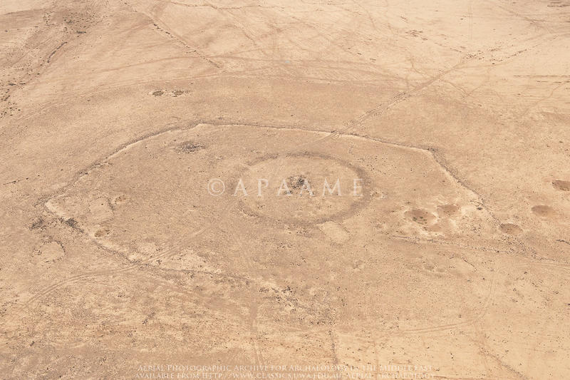 Figure 1: A 2009 aerial photograph (APAAME_20091019_DLK-0214 Jimal Stone Circle 2, Jimal Kite 3) shows two of the features now built over by the camp.