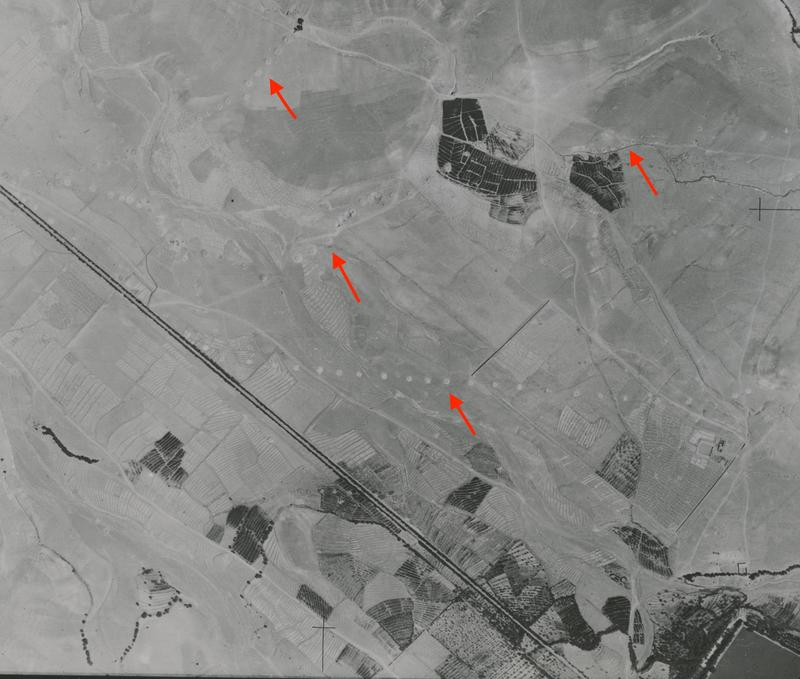 Fig.3. A vertical aerial photograph from Tabriz taken by 2 PRU squadron of the RAF on the 1 August 1941. The red arrows highlight the position of the visible qanat shafts, while part of the Elgoli reservoir can be seen in the bottom-right of the image. Th