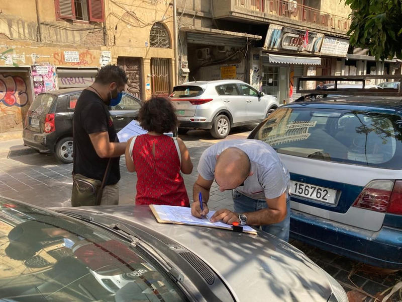 DGA staff recording damaged buildings on Gouraud Street, Medawar (photo courtesy of the DGA)