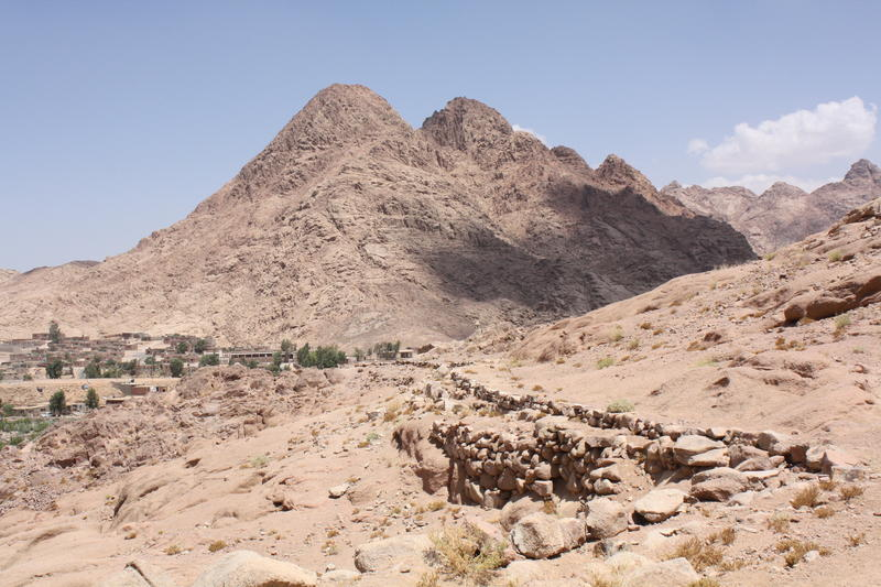 Figure 5 The Byzantine water conduit of Wadi Arba'ien (Leja) and contemporary water pipeline supplying Saint Catherine Monastery at average elevation of 1,600 m ASL (in the background are the pyramid-shaped Gebel Rubsha (El Ghabsheh) at 1,858 m ASL, and t