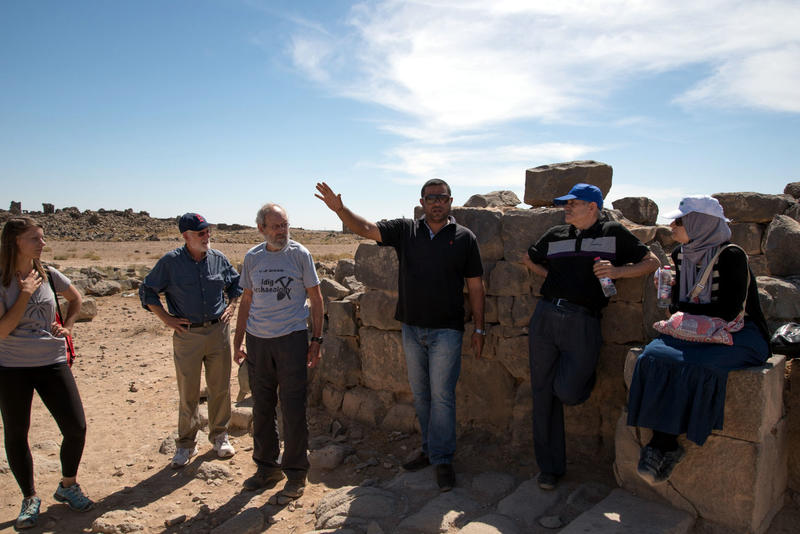 Figure 3: APAAMEG_20150927_REB-0048 – Muwaffaq Hazza speaks at the Gate of Commodus on the north west side of the town.