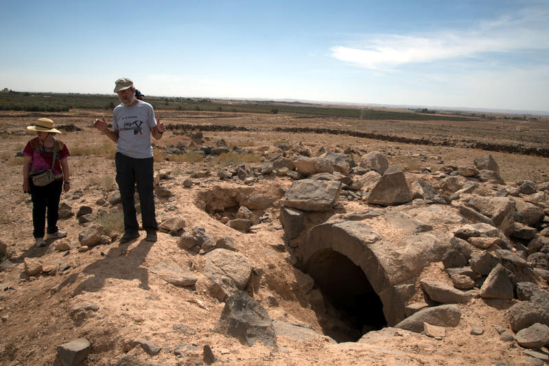 Figure 2: APAAMEG_20150927_REB-0052 – Bert De Vries stands next to one of the few remaining ancient monumental tombs