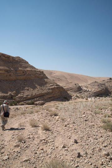 David Kennedy following the faint trace of the profile of a road into the Wadi Sueida. Photograph: Rebecca Banks.