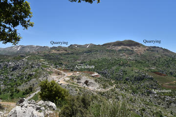 Figure 3: Photo taken from the southern slopes of Jabal Moussa, showing the impact of quarrying, a road and agriculture (facilitated through the easy access provided by the road) on the landscape surrounding the reserve.