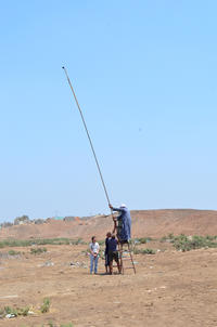 Figs. 11, 12: Using a 12m long metal pole to record archaeological features (courtesy of Italian mission in Beheira)